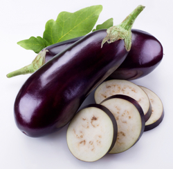 Eggplant, aubergine whole and sliced